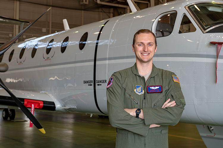 A C-12J Huron pilot with the 459th Airlift Squadron, 1st Lt. Danial Carr, poses for a photo, April 6, 2020, at Yokota Air Base, Japan. The C-12J pilots are responsible for aeromedical evacuation for all military personnel and their families in Southeast Asia. (U.S. Air Force photo by Airman 1st Class Brieana E. Bolfing)