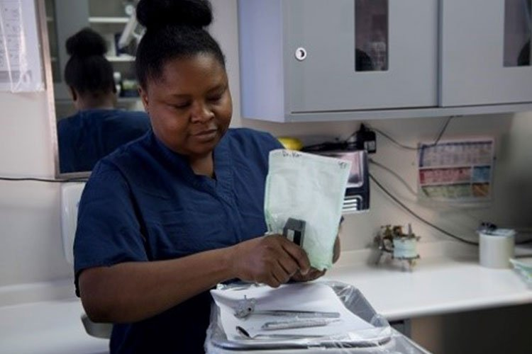 Marjorie Chery, Red Cross Dental Assisting volunteer, practices the proper way of opening sterilize instrument packaging during a Red Cross Dental Assistant class, Jan. 11, 2019, at Yokota Air Base, Japan. The course is offered at military bases worldwide including: Yokota Air Base, Camp Zama, Naval Air Facility Atsugi, Kaden Air Base, and Marine Corps Base Camp Smedley D. Butler. (U.S. Air Force photo by Senior Airman Donald Hudson)