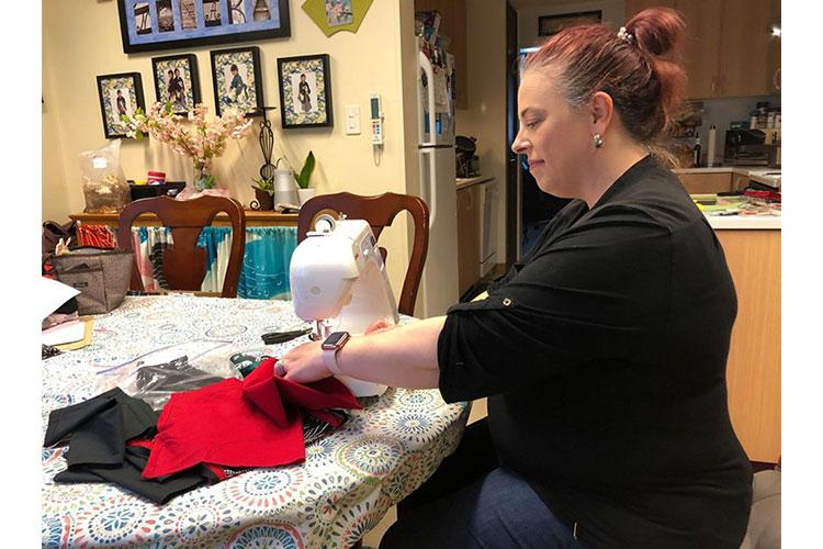 Erin Nonaka, a member of Camp Zama's Protestant Women of the Chapel group, sews washable, reusable cloth face masks at her home on Camp Zama, Japan, April 7. Goyne, along with three other PWOC members, began making the masks to donate to community members in the fight against the spread of COVID-19. (Photo courtesy of the Nonaka family)