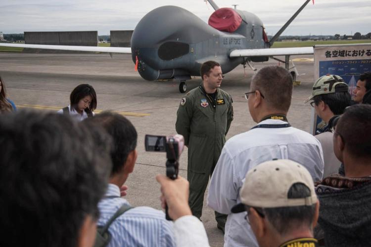 Maj. John Wright, a spokesman for the U.S. Air Force 319th Operations Group, answers questions about the RQ-4 Global Hawk at the annual Yokota Air Base, Japan, Friendship Festival on Saturday, Sept. 14, 2019. THERON GODBOLD/STARS AND STRIPES