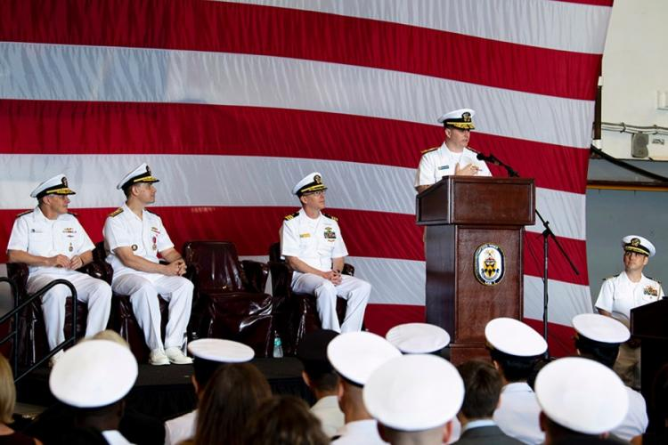 Rear Adm. Fred Kacher addresses his sailors after assuming command of the amphibious force for 7th Fleet from Rear Adm. Brad Cooper aboard the USS Wasp at Sasebo Naval Base, Japan, May 17, 2019. JEREMY STARR/U.S. NAVY