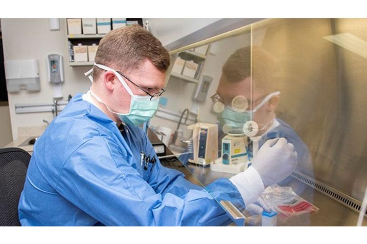 Army Spc. David Pyke, medical laboratory technician, loads a patient sample for rapid COVID-19 polymerase chain reaction testing at Brooke Army Medical Center, Fort Sam Houston, Texas, April 9, 2020. (U.S. Army photo by Jason W. Edwards)