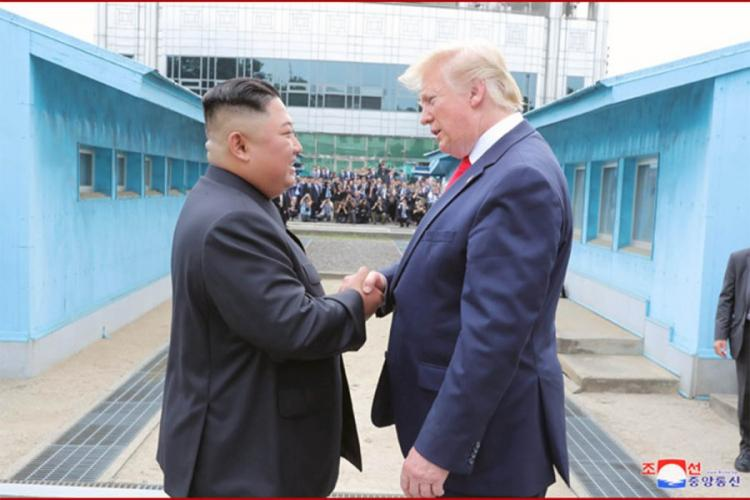U.S. President Donald Trump greets North Korean leader Kim Jong Un at the Joint Security Area on Sunday, June 30, 2019. VIA KCNA