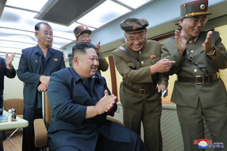 This undated photo, released by the state-run Korean Central News Agency on Aug. 17, 2019, shows North Korean leader Kim Jong Un observing the test-firing of a 'new weapon,' according to KCNA. KCNA
