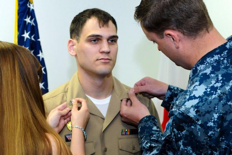 A sailor is pinned to petty officer first class during a frocking ceremony at Naval Air Facility Misawa, Japan, in 2016. RYAN DELCORE/U.S. NAVY