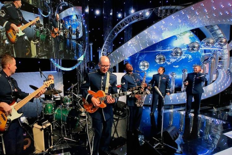 """Members of the U.S. Air Force Band of the Pacific — from left, Master Sgt. Josh Holdridge, Staff Sgt. Andrew Clemenson, Senior Airmen Pete Somerville, Derrick Newbold and Alycia Cancel and Master Sgt. Christin Foley — perform on a live broadcast of the Japanese TV show, """"Nodojiman The World!"""" in Tokyo on Wednesday, Sept. 11, 2019. MICHAEL D. HOERBER/U.S. AIR FORCE"""