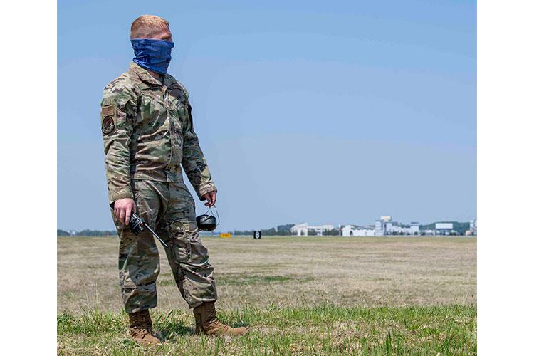 Staff Sgt. Aubrey Rice, 374th Civil Engineer Squadron firefighter, watches the flightline during an annual certification test of the aircraft arresting system at Yokota Air Base, Japan, April 29, 2020. The annual testing of the AAS is conducted by the 374th CES power productions shop and fire department as well as the 374th Operations Support Squadron airfield management flight. (U.S. Air Force photo by Airman 1st Class Brieana E. Bolfing)