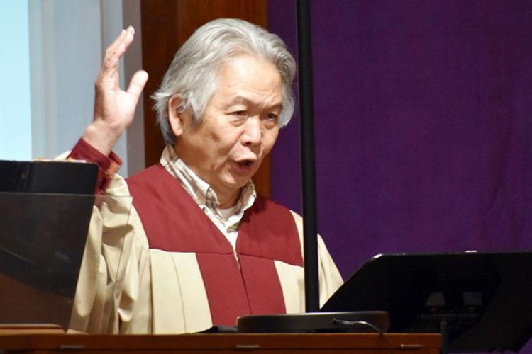 Shunji Sakita, director of the choir for the Holy Family Catholic Community, sings and directs the choir at the Camp Zama Chapel, Camp Zama, Japan, Feb. 17.