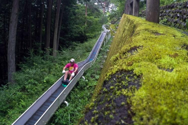 A rider picks up speed as he hits the steeper parts of Japan's longest roller slide in the village of Tabayama. THERON GODBOLD/STARS AND STRIPES