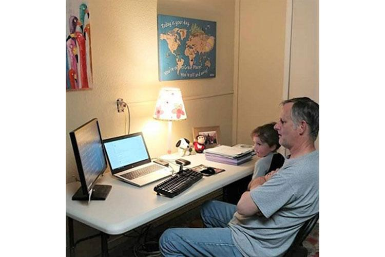 White Sands Missile Range Museum Curator Darren Court receives family support while teleworking at home. (Courtesy Photo/Melissa Court)