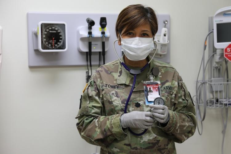 Lt. Col. Dolores Toney, a family nurse practitioner assigned to U.S. Army Medical Department Activity – Japan, poses for a photo May 11 in her examining room at the BG Crawford F. Sams U.S. Army Health Clinic Japan on Camp Zama, Japan. Toney, who has been in the medical field in the Army for 19 years, recently faced one of her most challenging and fulfilling experiences during the height of the COVID-19 pandemic.