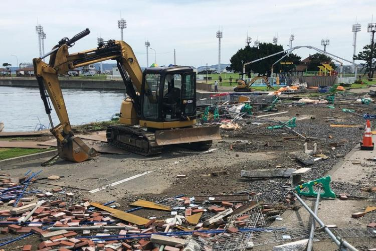 Workers clear debris from Typhoon Faxai at Yokosuka Naval Base, Japan, Monday. Sept. 9, 2019. CHRISTIAN LOPEZ/STARS AND STRIPES