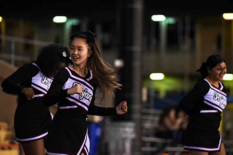 Zama American Middle-High School cheerleaders entertain the crowd during a matchup with the Matthew C. Perry Samurai at Camp Zama, Friday, Oct. 25, 2019. THERON GODBOLD/STARS AND STRIPES